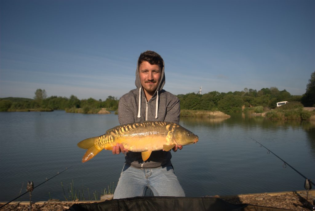 A perfect 11lb mirror, caught early on a stunning summer's morning.